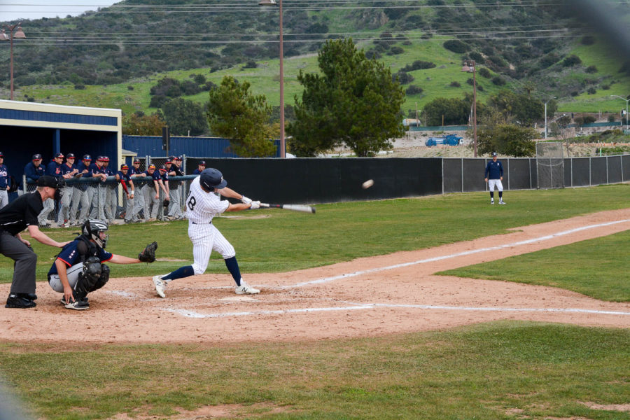 Liam O'Connor swings for the fences against Dana Hills. On Monday, March 11 baseball played against Dana Hills High High School, eventually losing     6-1.