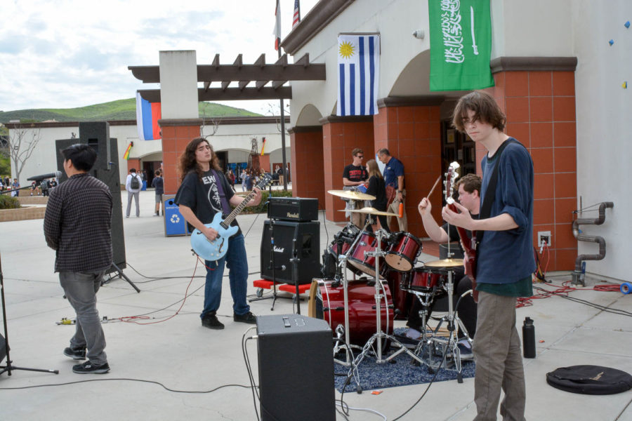 Lead singer Paul Shin, lead guitarist Cristiano Arbiso, bassist Ryan Hellwege, and drummer Austin Monroe perform an original song 'Pseudo Spiritual' and 'A Song for the Dead' by the Queens of the Stone Age in the quad at lunch during the second day of Battle of the Bands.