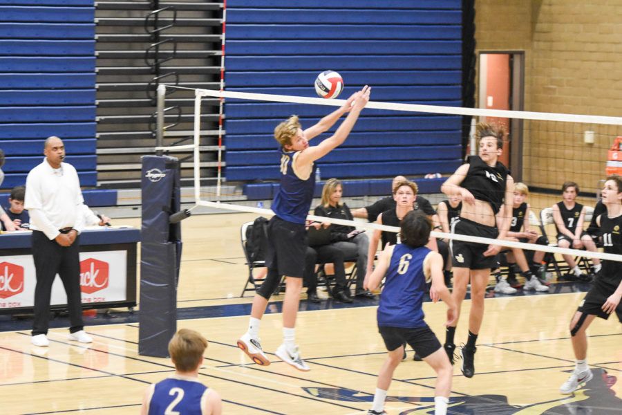 Jack Collins goes to block a spike against JSerra while Matt Luziriaga and Elliot Macadam watch. The stallions would eventually lose 3-1.