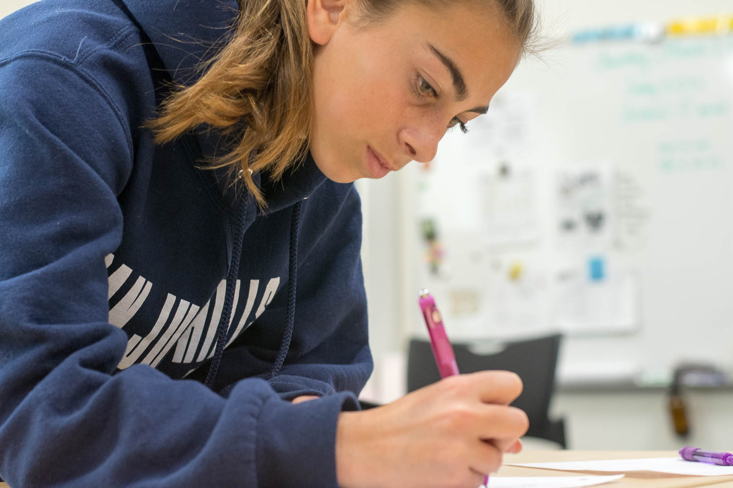 Freshman student, Sam Gugliuzza prints her name on sign up sheet for Donate-A-Dance. Gugliuzza, along with several other students gathered in Mrs.Bak-Boychuk's room on March 6th to join the club and took the lunch period as a time to discuss upcoming plans and goals for Donate-A-Dance.