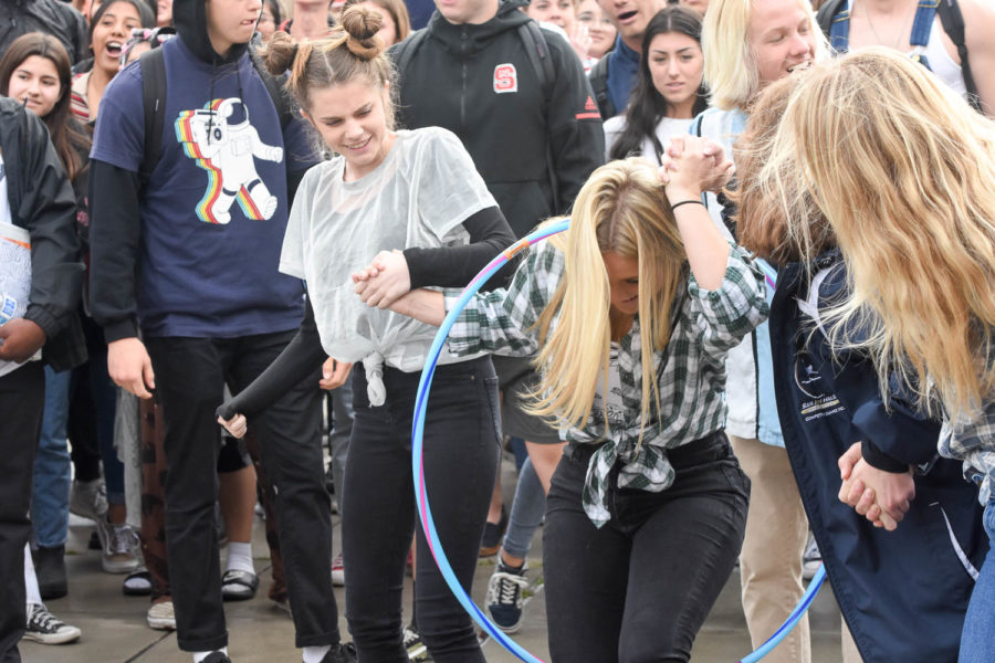 Juniors, Marissa Berry, Haley Maniscalco and others help the class of 2020 in a hula hoop competition. Juniors got first, followed by seniors, freshmen, and then sophomores.