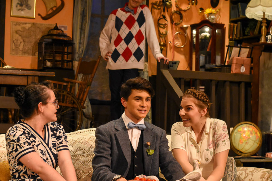 In this scene from You Cant Take it With You, Tony Kirby (Matthew Duplissey) meets Penny Sycamore (Allison Nicolai) and Essie Carmichael (Reagan Barclay), with Ed Carmichael (Connor Keithley) watching attentively.