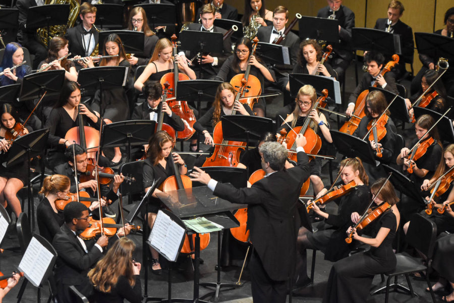 Mr. McElroy conducts the full orchestra playing Dance of the Comedians and Hungarian March at their concert on March 12. The Full Orchestra performed at Segerstrom Hall and received unanimous superiors from the judges.