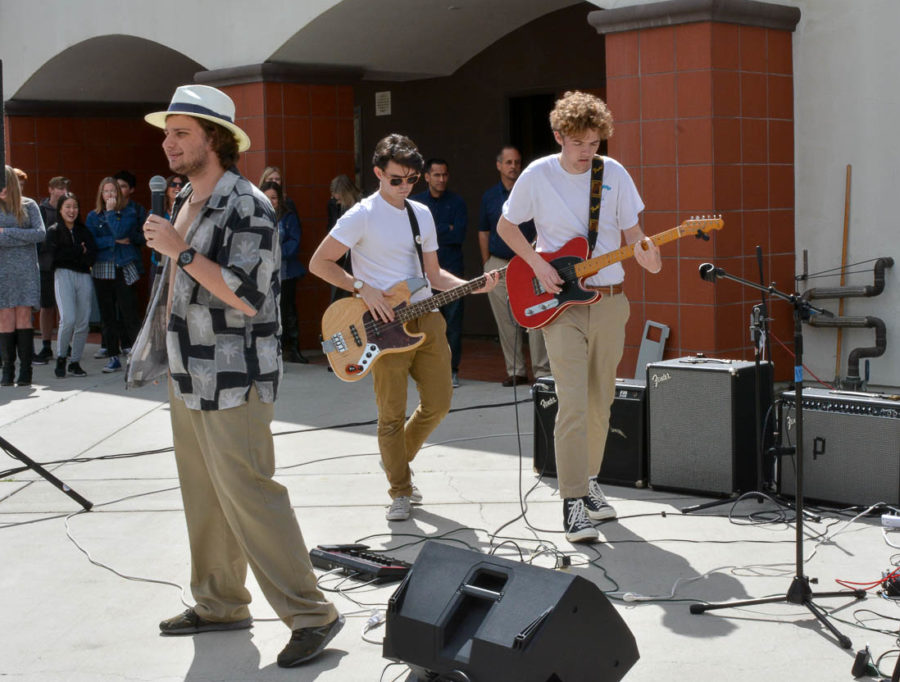 Lead singer Liam Fahey sings to the massive crowd while his two guitarists Dylan French and Connor Rose play in the background. All of the band members wore tan to represent their band name, The Tan Band. The Tan Band ended up winning the competition and played a multitude of songs for the student body on Friday, March 15th.
