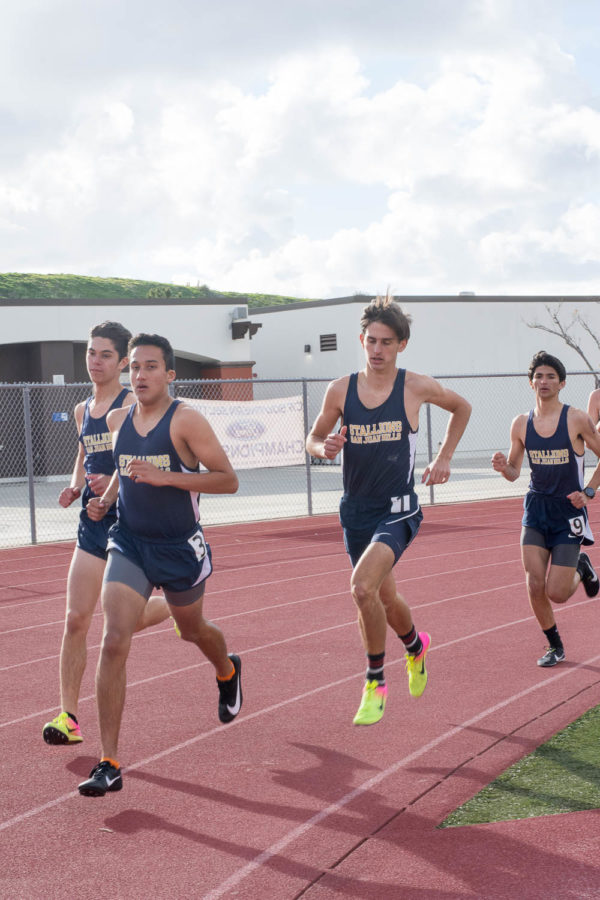 Raymond Rojas (11) leads in the 1600m meter race at the intrasquad track meet on Thursday, February 21, with Josh Dalo (12), Cole Smith (12), and Dalton Flores (12) catching up behind him.