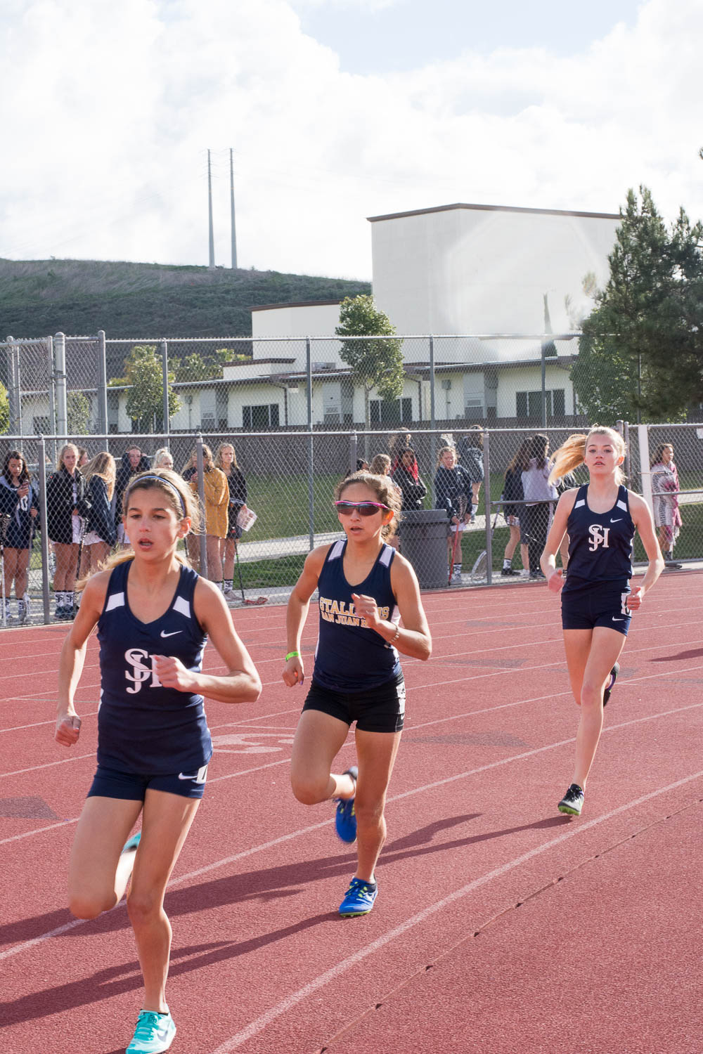 Shirin Dunker (9), Isabella Zuniga (10), and Emili Peo (9), finish in first, second, and third place in the Varsity 1600 meter run at the intrasquad track meet on February 21 in the Badlands.
