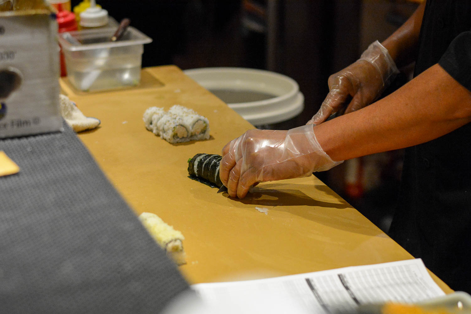 A chef at Zenko Sushi makes a California Roll and Crunch roll for a couple that came in as soon as they opened on Monday at 5:00 PM. They are typically open at 10:30-2:30 PM, and then reopen 5:00- 9:30 or 10 PM depending on the day of the week.