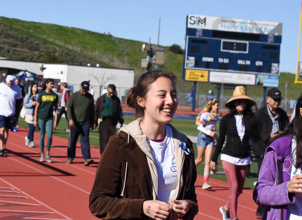 "Jessica Tonai (11) walks around the track during the ""Walk For Wellness"" in February. Project SOS raised over $4,500 for Mission Hospital's mental health ward and had over 180 participants."