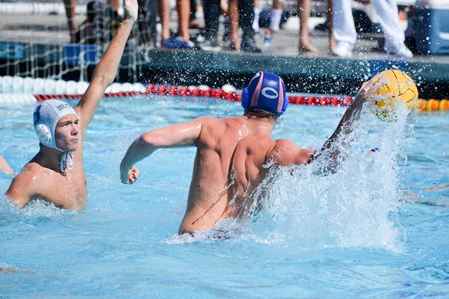 Max Miller (11) winds up to take a shot on goal. Unstoppable in the pool, Miller is a key player on SJHHS' boys water polo team.