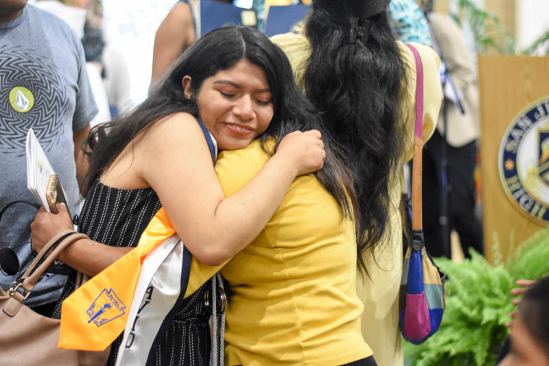 Celia Aguilar, the Stallion of the Year, hugs a friend with tears of joy. She was selected among five other Stallions and has a picture hanging in the front office to honor her achievements.
