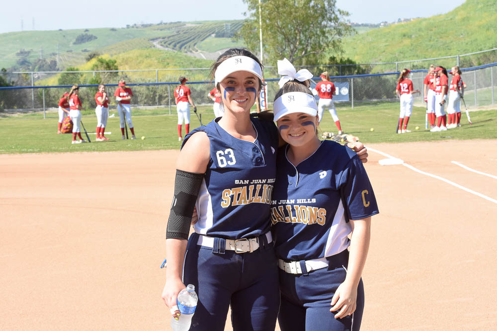 Catcher, Sabrina Javorsky and pitcher, Phoebe Popplewell smile together before a game together against Mission Viejo.
