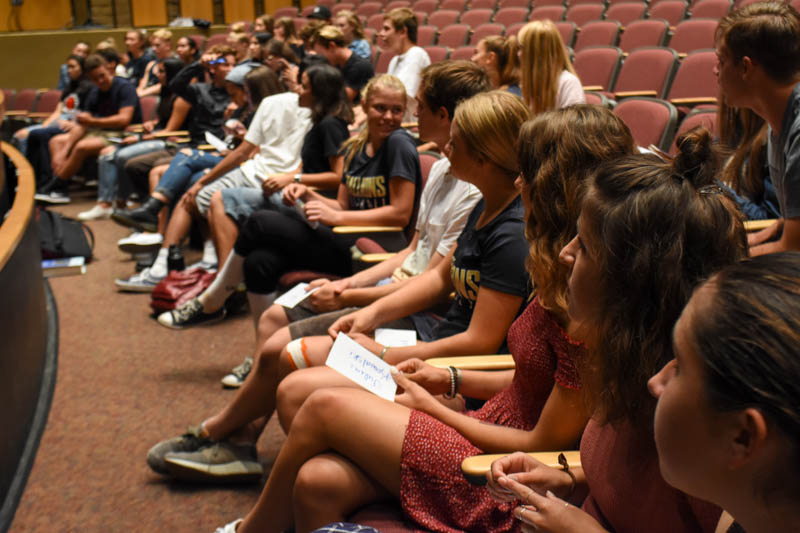 Students who were accepted into National Honors Society sit and listen to instruction during the rehearsal meeting.