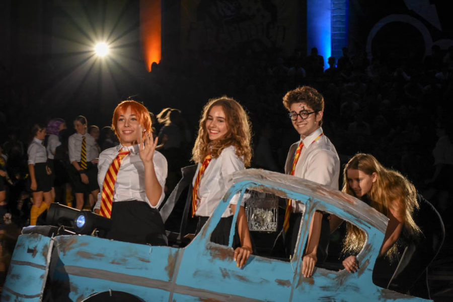 Driving away: Advanced dancers, Katie Phillips (11), Julia Kowalski (10), and intermediate dancer Zach Rothman (12) are in a car that resembles the flying car from the second book of the Harry Potter series. Katie is Ron, Harry's best friend, and Julia is Hermione, the third best friend of the books trio.