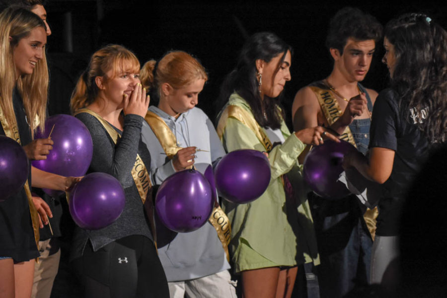 Senior Homecoming Court: [Left to right] Seniors Brooke Montgomery, Grace Aitken, Sage Groves, Hanna Talieh, and Cam Traverso wait in anticipation for the announcement of the Homecoming king and queen at the pep rally. Unfortunately, the results were stolen and the winners were announced at the football game later that night.