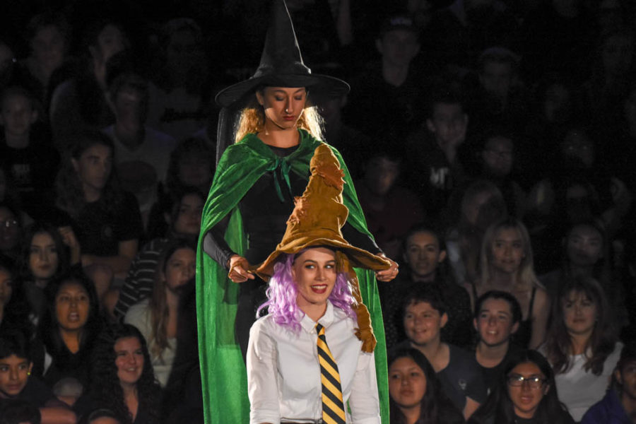 Sorting Hat: Alexa Burns (9) places the sorting hat on Victoria Schultz (12) head during the dance production's performance of Harry Potter. Victoria Schultz was a member of Hufflepuff which was the freshmen house. The sophomore class was Ravenclaw, the juniors were Slytherin, and the seniors were Gryffindor.