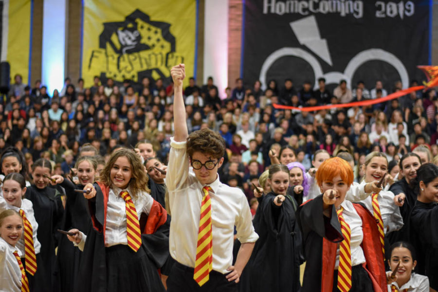 Intermediate dancer, Zach Rothman (12) strikes a pose as Harry Potter. He wears a red and gold tie which are the colors of the Gryffindor house that Potter belongs to. The rest of the dancers are in Gryffindor as well and they cast a spell behind him.
