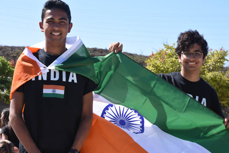 Kayden Kadri (11) and Sohum Joshi (11) pose with the Indian flag and accompanying t-shirts as they promote their Indian Culture Appreciation Club. The club meets every second Wednesday in Mr. Lewis' room, J202, where they share the Indian culture with all who attend.