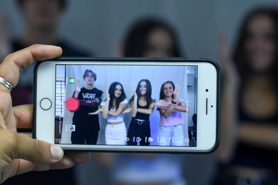 Cole Caselli (9), Vivian Landa (11), Emma Seemann (11), and Madelyn Earnest (10) pose for a TikTok. Each student has achieved thousands of followers on the new social media app. Through dancing, lip-singing, or just having fun helped these creators reach fame, and truly become TikTok famous.