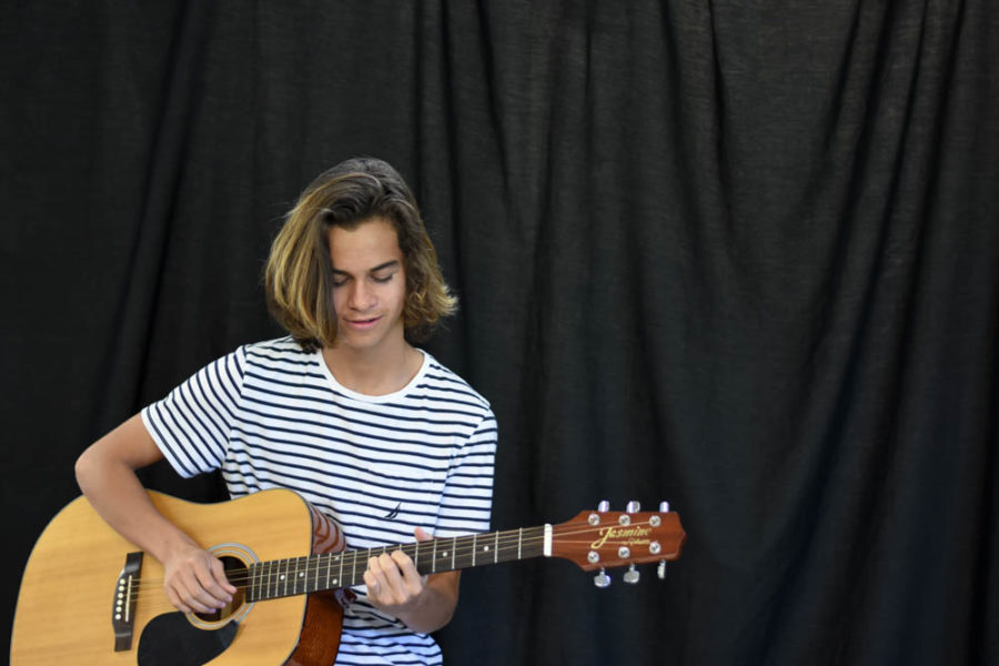 "Jeremey Mitaux (11) is involved with music in many different ways as a guitarist, drummer, and most notably, a bassist for the band ""White Collar"". He also writes music and lyrics to his own songs as an individual and has expressed interest in continuing his musical production after high school."
