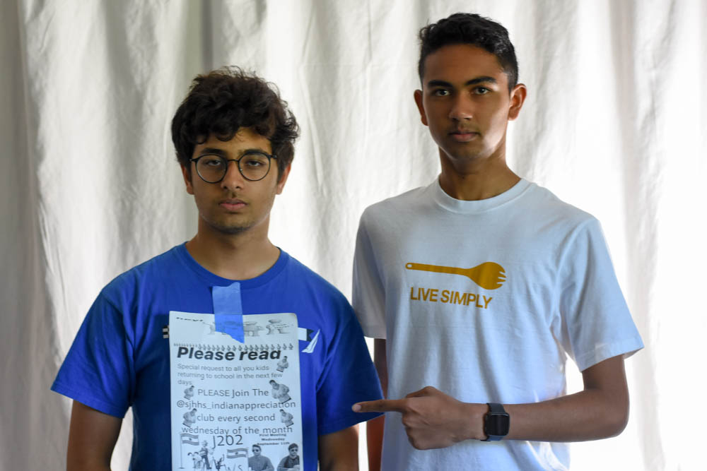 Kayden Kadri (11) and Sohum Joshi (11),  presidents, of the Indian Appreciation Club, pose with their poster promoting the Indian Appreciation Club's first meeting. The club was created just this year in hopes to appreciate Indian culture.