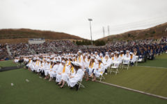 The class of 2019 graduates from SJHHS on June 6. Students who received a 4.0 or above are seated at the front in white robes, while the rest are behind them in blue.