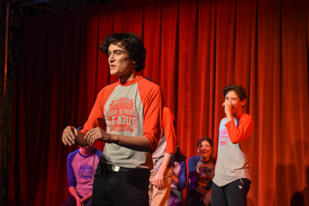 Cooper Murr (12) performs his fantastic impression of Marge from The Simpsons in order to make the crowd the laugh during the Comedy Sportz match against Santa Margarita High School.