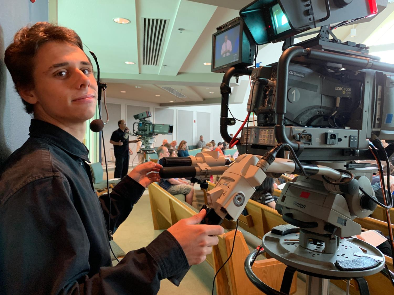 Oliver Rudolph (12) works the camera filming his church service. In addition to recording films for his church, Rudolph works on music videos, that can be found on various social media platforms.  Currently, he is pursuing a career in the film industry.