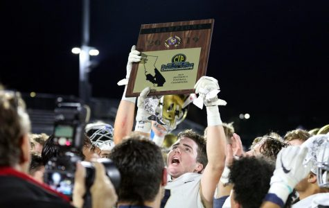 Jonah Johnson (12) raises the CIF Championship Plaque in celebration with his teammates and coaches. The Stallion Football team took home the title on November 29 in a game against Loyola High School. They won the game 21-15, earning the school's first ever CIF championship in football.