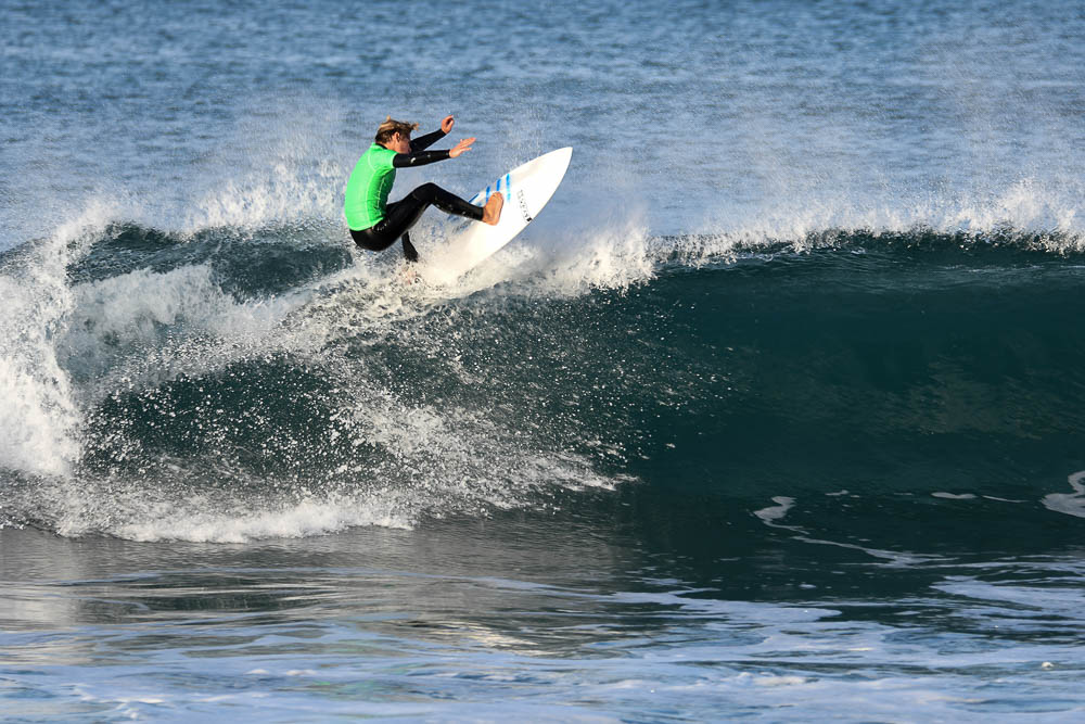RIDING THE WAVES: Chris Matthews (10) smacks the lip with a pristine snap during a competition at the Ritz Carlton in Salt Creek, Laguna Niguel. Chris Matthews and the rest of the San Juan Hills High School surf team won this meet, helping them win a league title.