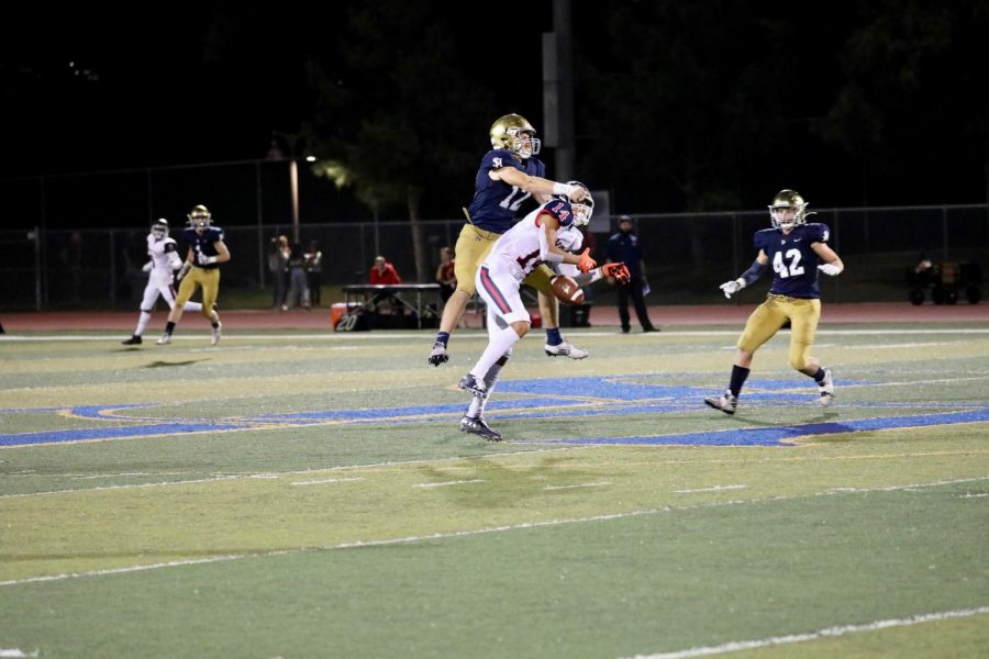 Joey Hobert (12) forces an incompletion against Great Oak. The Stallions went on to win 35-7, the start of a nine game winning streak.