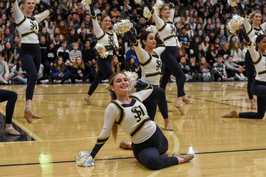 Jamie Lewis (11) dances in the grand finale of the winter formal pep rally. Lewis is in advanced dance, though the pep rally featured dancers from intermediate and advanced.