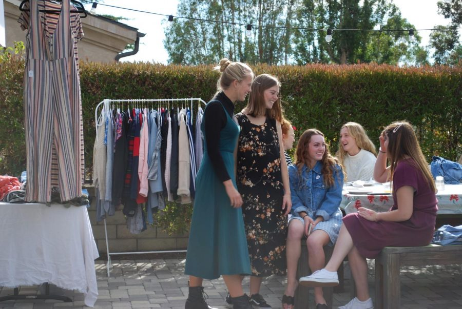 Dressember club members Corinne Hunnicut (12), Riley Goodfellow (12), Shayla Mauerman (12), Bella Mincer (12), and Ellie Rene (12) talk at a Dressember event to kick start the month. They wore dresses everyday in December to raise money and awareness for human trafficking. There was a dress swap and all participants had breakfast together. The club raised over $7,000 in 2019.
