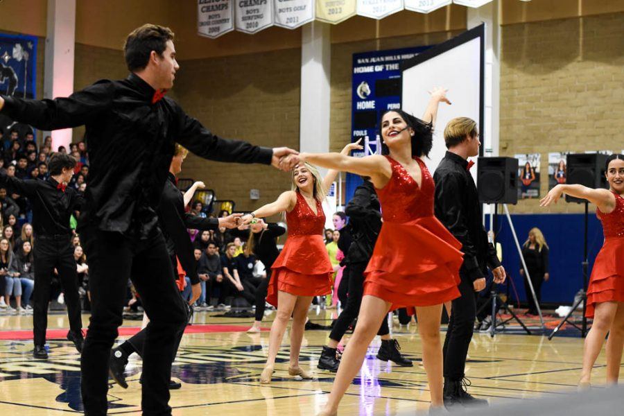 During dance production's performance, advanced dancer, senior Jordyn Apostolache (12) dances with Max Miller (12). Every year at the Winter Pep Rally, dancers pick a partner to dance with for a song, even though he may not be involved in dance.