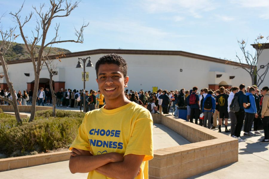 Bryce Connor (10) wears the Kindness Week shirt provided by ASB to promote kindness among a crowd of students. Students and teachers around campus wore yellow in support of spreading kindness.