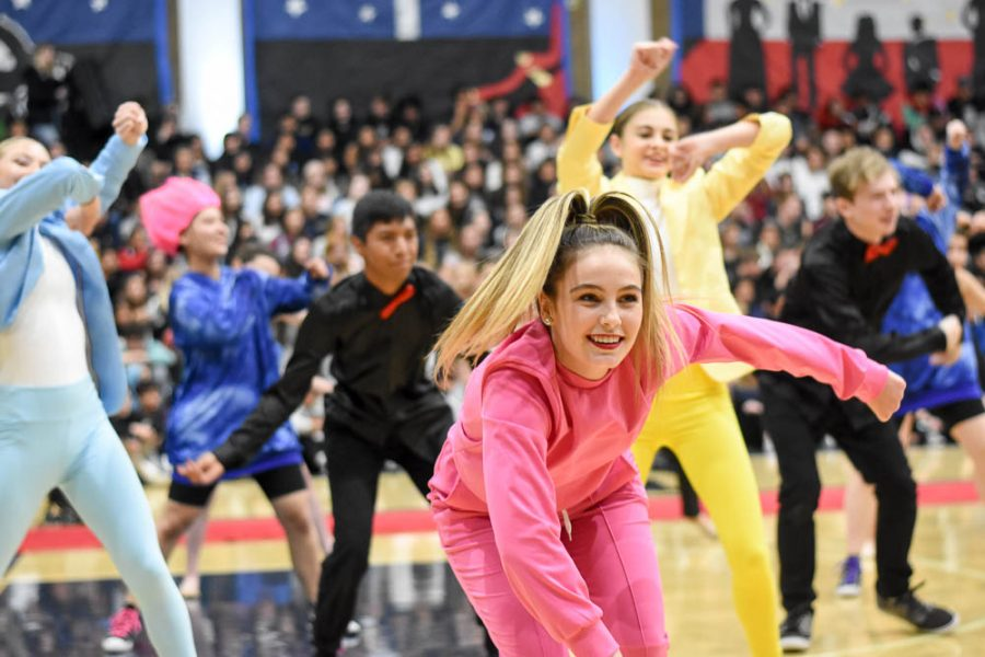 Jamie Lewis (11) dances in the finale of the winter formal pep rally, a mix of dancers from every routine. Lewis is in advanced dance, though the pep rally featured dancers from intermediate and advanced dance.