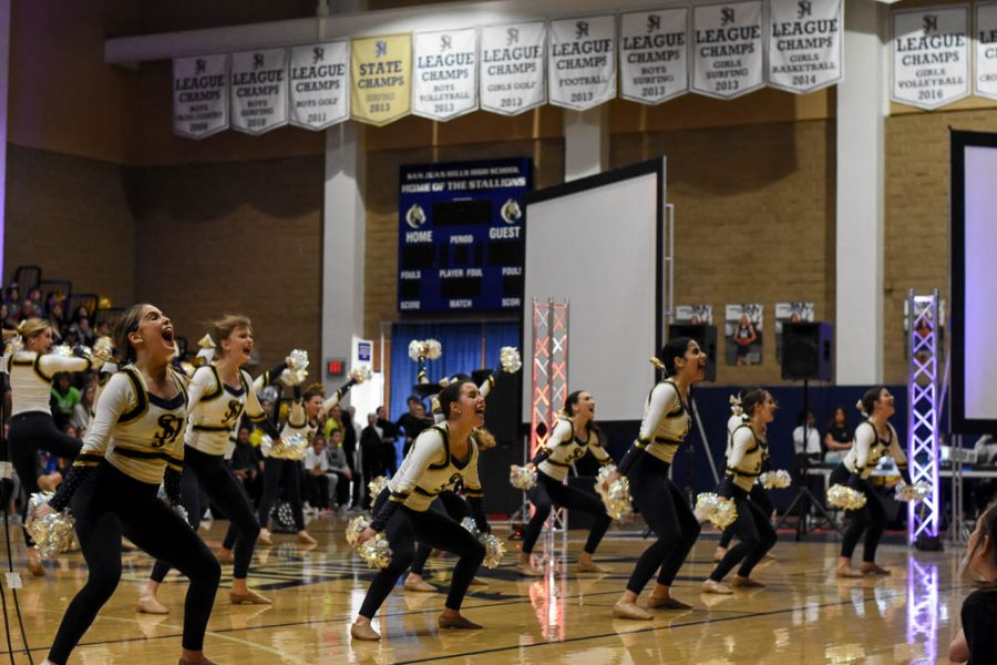 The Stallion Song Team chants a song to engage the crowd at Friday's pep rally. The performance included the Intermediate Advanced dance teams as well.