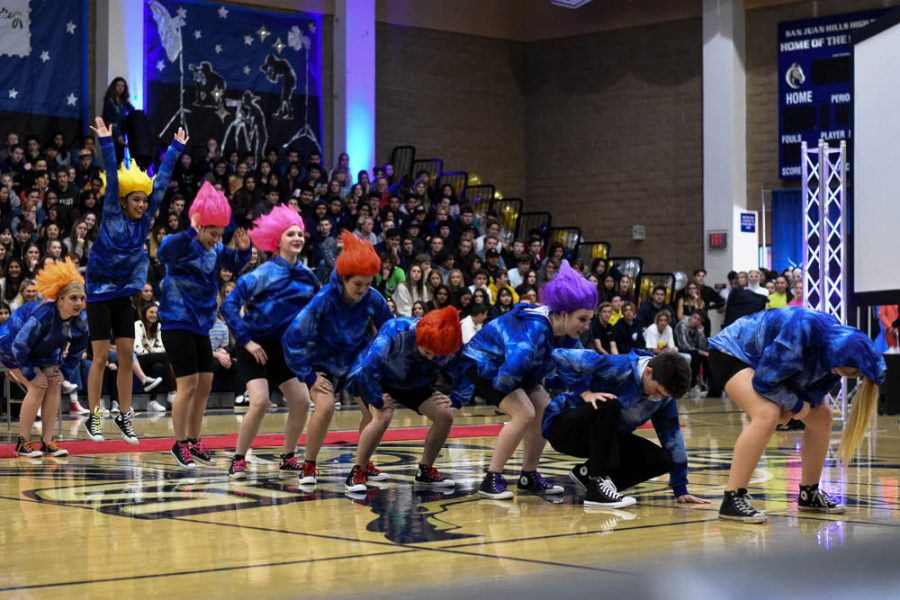 """The Dance Production team collectively jumps up to the song """"Hair Up"""" from the phenomenon, Trolls. The room flashed between colorful lights while the dancers continued to perform in sync."""