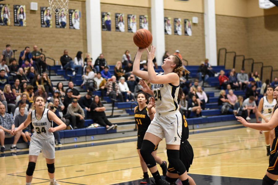 Grace+Gentry+%2812%29+positions+herself+to+make+a+basket+during+Tuesday%E2%80%99s+Senior+Night+game+against+Mission+Viejo+High+School.+Gentry+finished+with+14+points+as+the+Stallions+beat+the+Diablos+by+a+score+of+59-27.