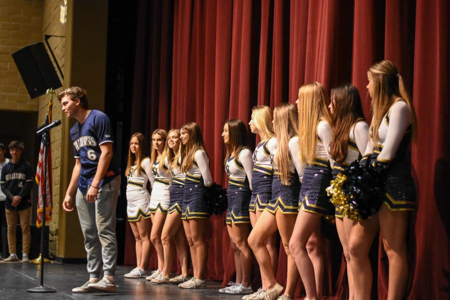 Varsity baseball player Ethan Pope (12) speaks to an audience of future stallions and parents about the college he has committed to play baseball for. Other athletes announced their college plans to inspire eighth graders about the benefits of attending SJHHS.