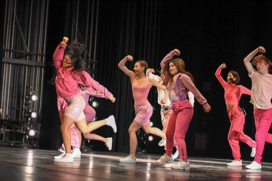 Beginning intermediate dancers perform on the stage during Stallion Showcase. The dancers choreographed their dance for the student choreographer show titled, Game On! This dance was inspired by the video game, Hip Hop Dance Experience and included a compilation of music ranging from Cardi B to Iggy Azalea.