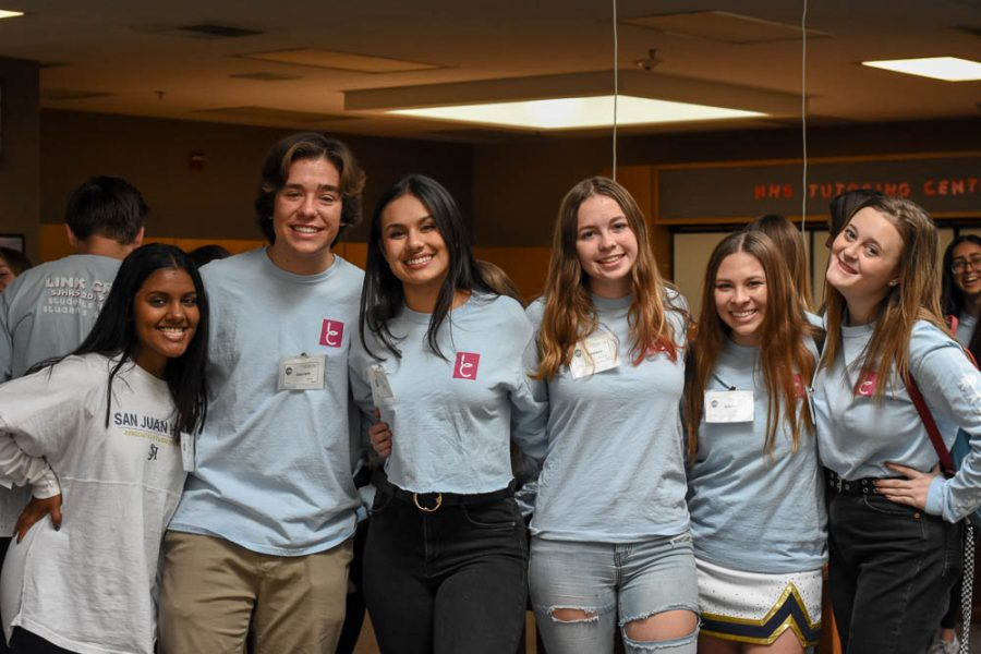 (Left to Right) Junior link crew leaders, Sri Ghosh, Garrett Gattis, Siena Chacon, Tamsin Sherwood, Jillian Tabone, and Sydney Howes pose together in the library during Stallion Showcase. Link crew leaders spent their time giving tours of the school to incoming freshmen.