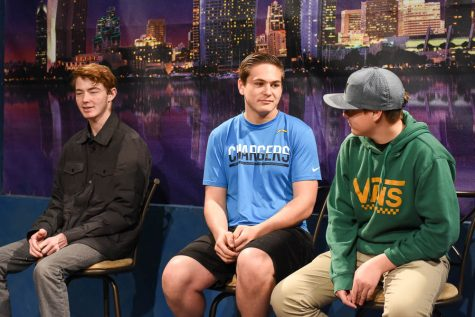 From the left, Schafer Welsch (12), Ryan Sisson-Burack (10), and Parker Gorton (10) are filmed for an episode of The Mane Event. Behind the scenes, the students work together to adjust the sound, lighting, and camera for the edition.