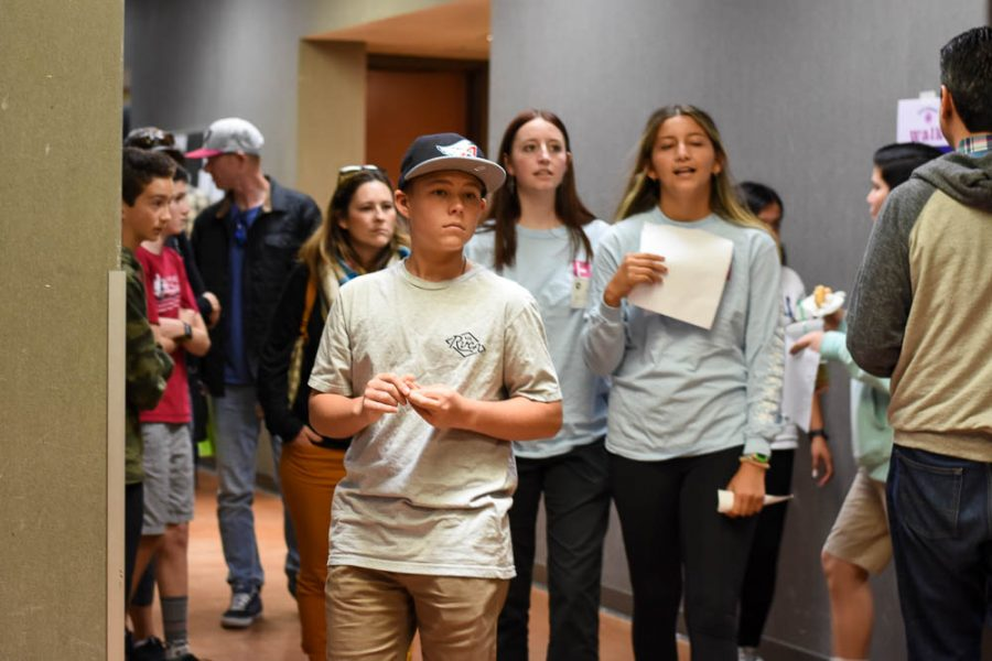 An incoming freshman tours the F building with Link Crew leaders Lucy Hughitt (11) and Jade Hernandez (11). Visual and performing art classes set up booths in the halls to promote their programs in hopes of expanding student interest.