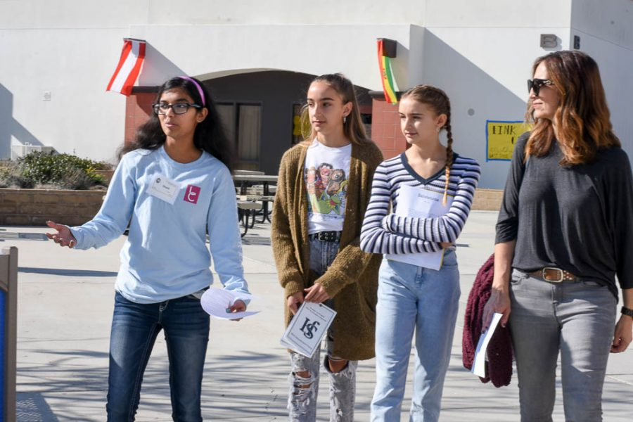 Link Crew leader Shali Patel (11) shows the incoming Stallions around the Upper Quad. In the upper quad, there were numerous booths demonstrating electives and clubs at San Juan Hills.