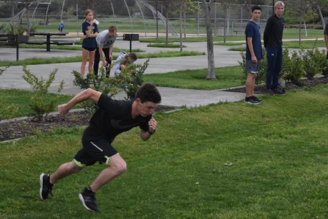 Cameron Fox (12) and the San Juan Hills track team came together at Sendero Park to work on their sprints in a relay race. During spring break, instead of coaches, team captains in track for distance, jumps, and sprints, organized workouts in order to keep the team in shape for the return of the season.
