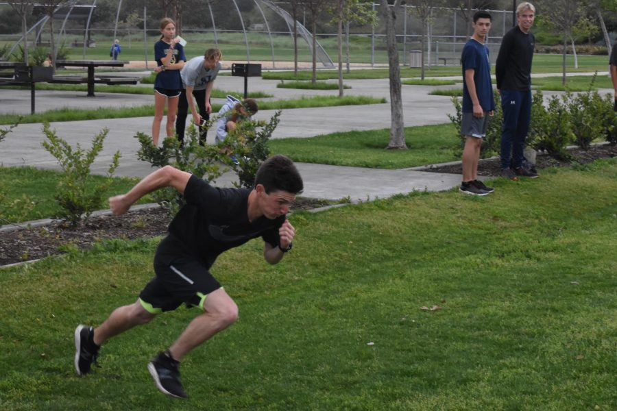 Cameron+Fox+%2812%29+and+the+San+Juan+Hills+track+team+came+together+at+Sendero+Park+to+work+on+their+sprints+in+a+relay+race.+During+spring+break%2C+instead+of+coaches%2C+team+captains+in+track+for+distance%2C+jumps%2C+and+sprints%2C+organized+workouts+in+order+to+keep+the+team+in+shape+for+the+return+of+the+season.