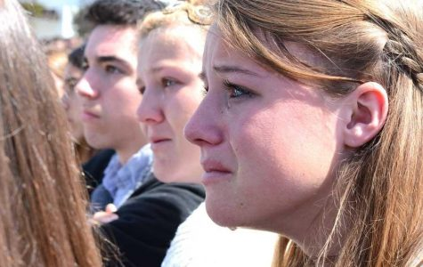 In 2016, seniors Tess Smolders, Claire Taylor, and Damian Ballard react to the mock crash scene depicted in the Every 15 Minutes program.