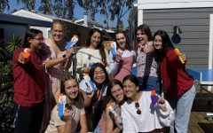 A group of seniors pose with their guns on the first day of Senior Assassins. The game was cut short last week due to COVID-19 concerns, the first year without a winner.