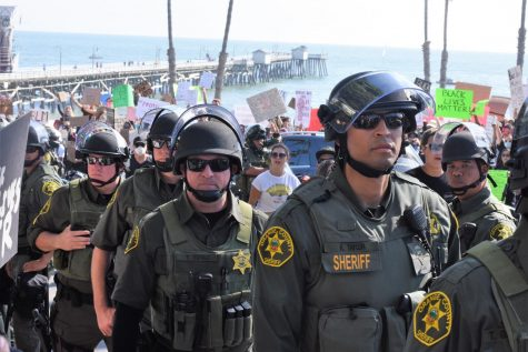Police officers line up near the San Clement Pier to keep protestors from blocking traffic. On May 31, Black Lives Matter protestors came to San Clemente to voice their frustrations about the death of an African American man, George Floyd, at the hands of Minneapolis police officers.