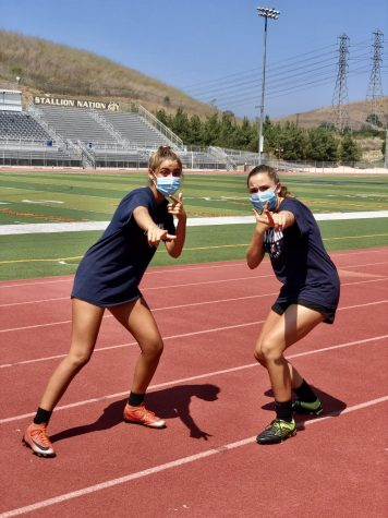 Haley Juarez (10) and Alexa Bradford (10) wearing their masks, while waiting for their social distanced soccer practice at the Badlands to begin.